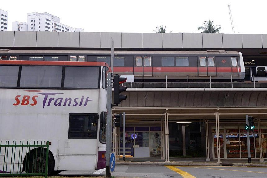 A train at the MRT station and public bus at the traffic junction in Ang Mo Kio on Jan 21, 2015.