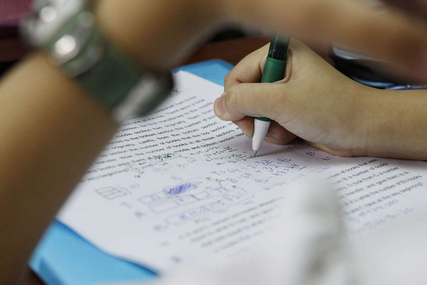 A pupil working on a revision paper.