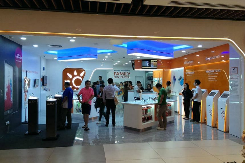 M1's newly revamped store at IMM. Malaysia's Axiata Group Bhd is not in any negotiation to raise the regional telecommunication firm's stake in Singapore's M1 Ltd.