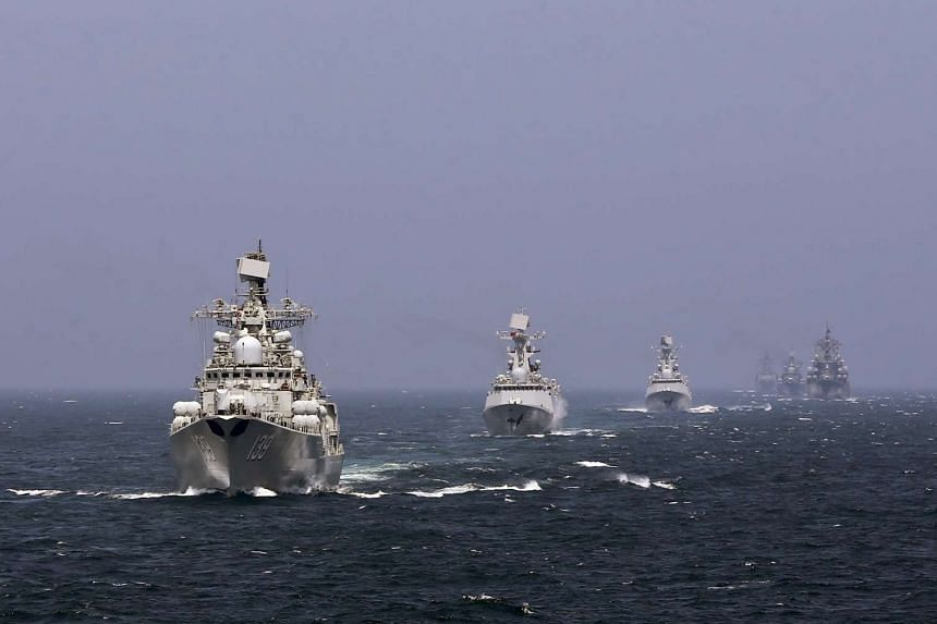 Chinese and Russian naval vessels participate in the Joint Sea-2014 naval drill outside Shanghai on the East China Sea.