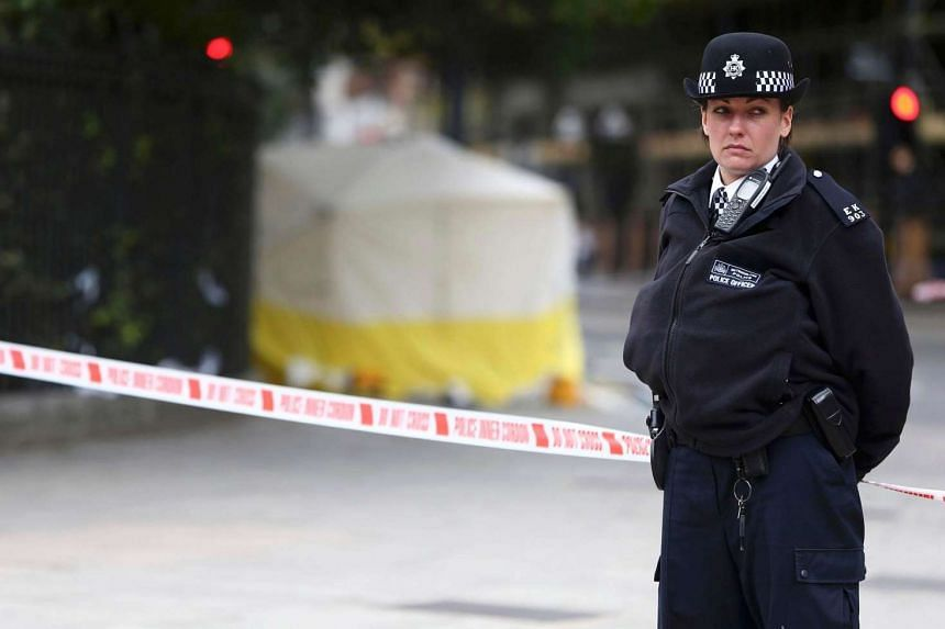 A police officer stands guard in Russell Square on Aug 4. British police arrested 55 people and seized blades at a Sikh temple on Sunday (Sept 11), following a protest against a mixed marriage.