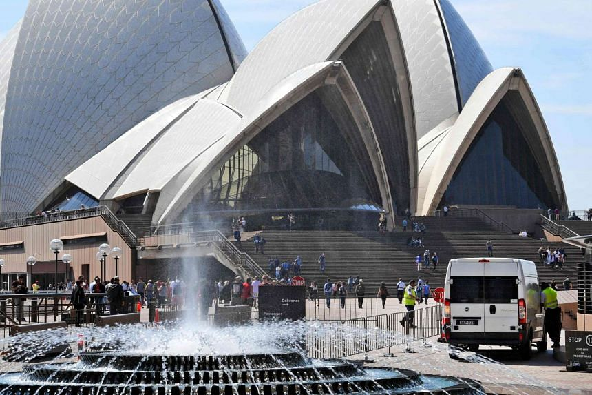 Vehicles are stopped at a checkpoint at the Sydney Opera House on Sept 9, after an 18-year-old man was charged after allegedly making threats at the Sydney Opera House, just days after the so-called Islamic State group urged followers to target high-