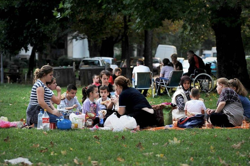 People gather in the streets and parks near Skpoje on Sept 11, 2016 after a moderate 5.3-magnitude earthquake, preceded by two tremors, struck the Macedonian capital.