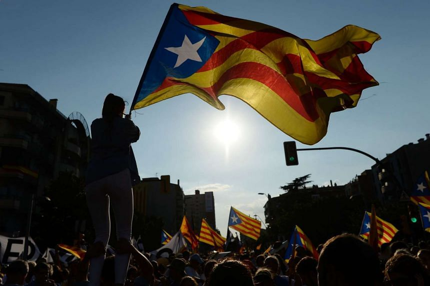 A shot of the Catalan flag being waved on Sept 11, 2016, in Barcelona on the National Day of Catalonia.