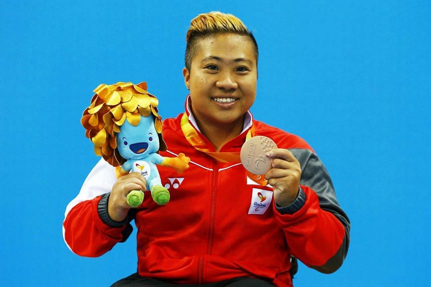 Theresa Goh posing with her bronze medal after the medal ceremony.