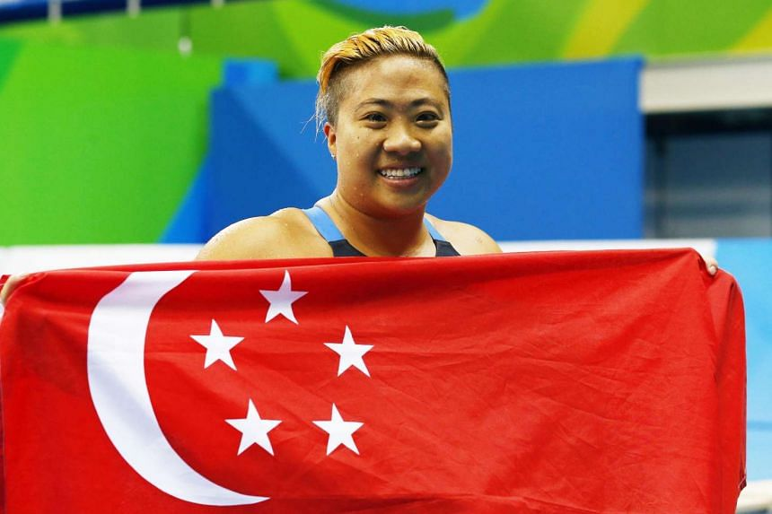 Theresa Goh poses with the Singapore flag after her bronze medal win.