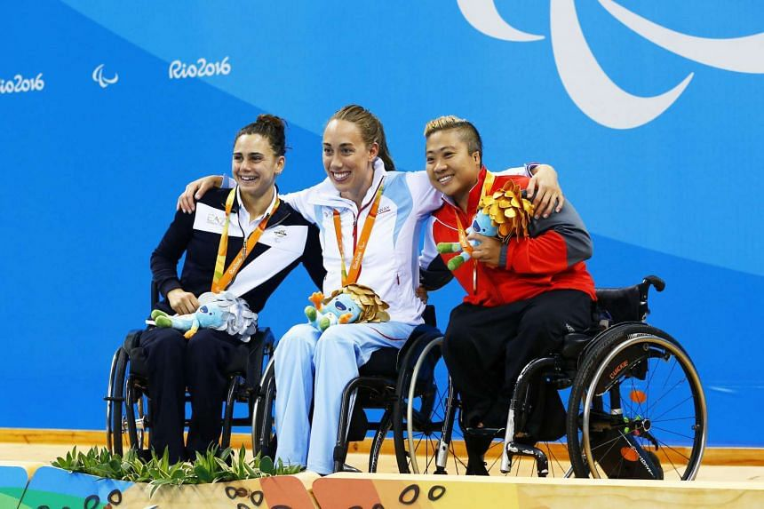 Italy's Giulia Ghiretti, Norway's Sarah Louise Rung and Singapore's Theresa Goh celebrate their medals.