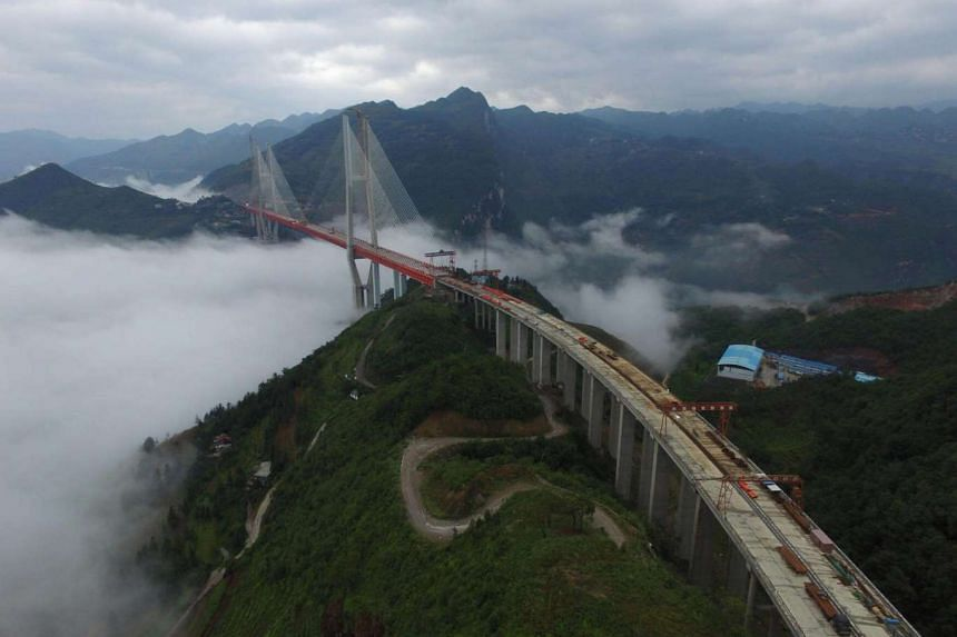 An aerial view of the Beipanjiang Bridge under construction; it will connect two provinces in Bijie.