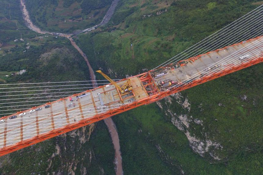 The Beipanjiang Bridge, in mountainous south-western China, soars 565m above a river.