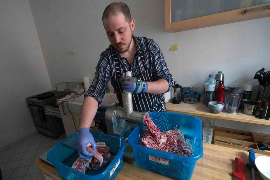 Richard Holmes prepares his homemade British style sausages named Britwurst in his Vienna apartment on March 16, 2016 in Vienna, Austria.