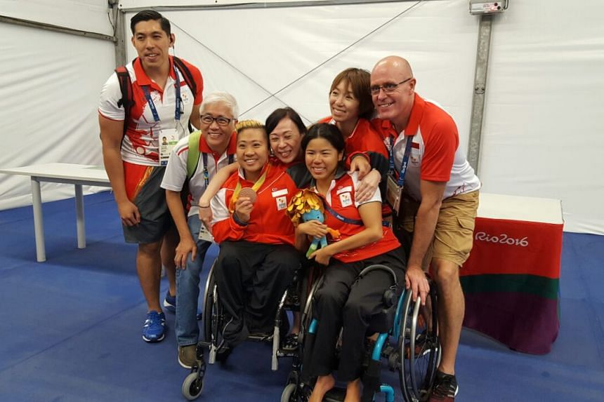 Theresa Goh celebrates her bronze medal win with family and friends.