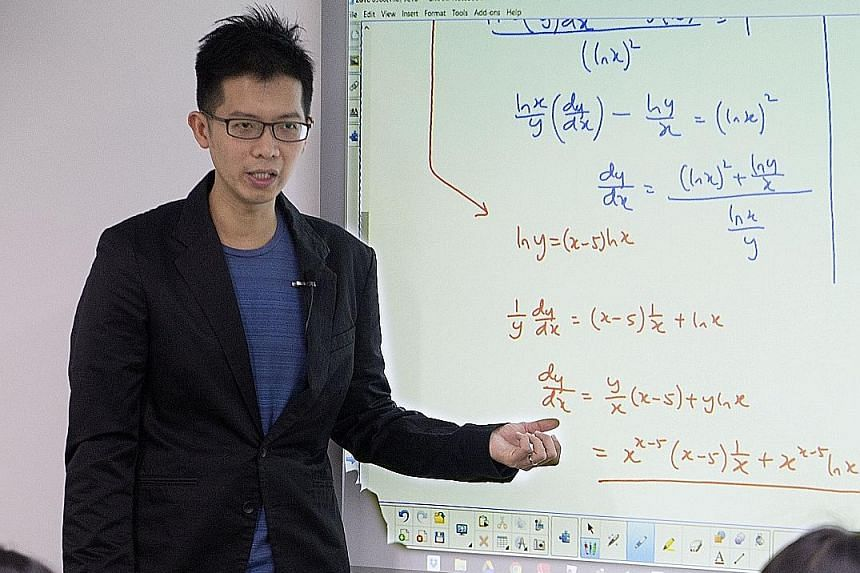 Mr Ang conducting a mathematics class for junior college students. He encourages students to create their own study notes, and, like other educators, said that studying on the day before an exam is too late.