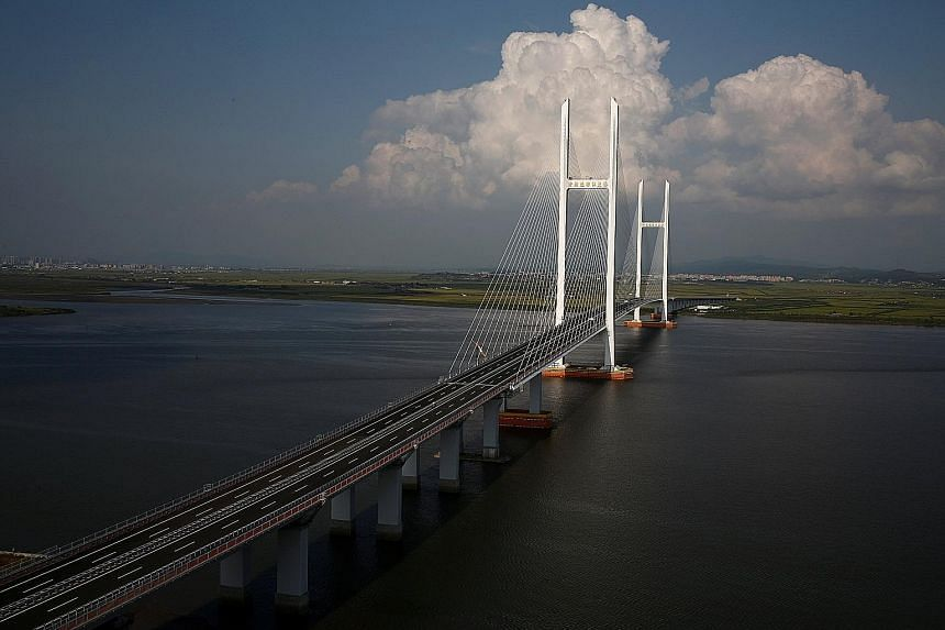 The unfinished New Yalu River Bridge that was supposed to connect Dandong in China with North Korea (far side). The North's nuclear ambitions make it unlikely that China will carry out economic development with the country.