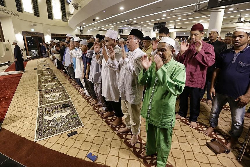 Muslims marking today's Hari Raya Haji festival by praying yesterday evening at Singapore's newest mosque, Maarof Mosque, which opened last month in Jurong West. They also recited the takbir in celebration of the festival. The takbir proclaims the gr