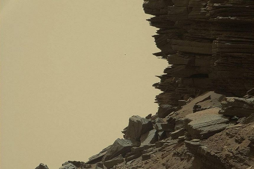 New images of the surface of Mars have been released by US space agency Nasa, and may help scientists understand how the planet's landscape, once favourable for life, changed into the current uninhabitable conditions. The colour photos, taken by the
