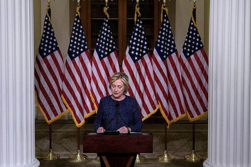 """With election day looming, and the race still tight, Mrs Clinton on Saturday went into damage limitation mode over her remarks about """"half"""" of Mr Trump's supporters."""
