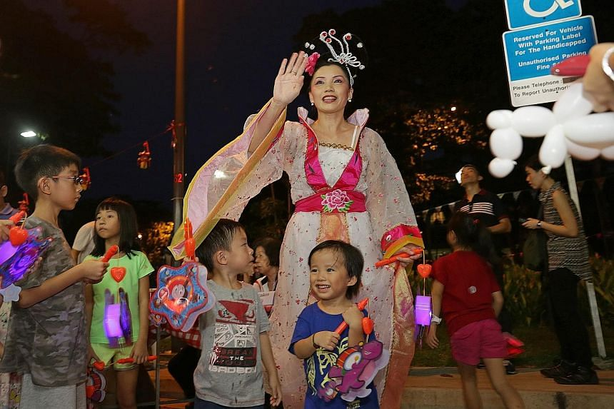 Children yesterday getting ready for a lantern walk at Joo Chiat's Mid-Autumn Festival celebration, which ESM Goh attended.