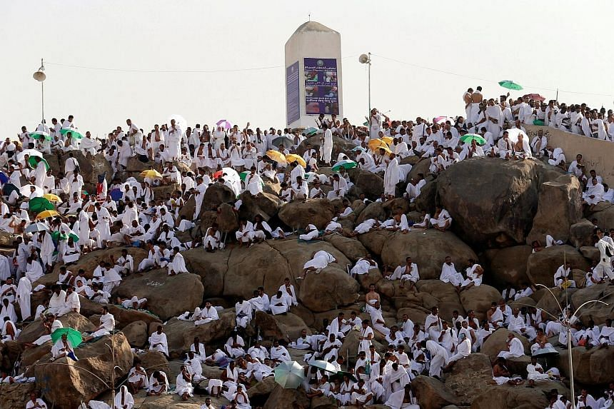 Pilgrims on the plains around Mount Arafat yesterday before the stoning of the devil ritual today. Helicopters monitored the crowd flow while policemen directed pedestrian movement, as part of safety measures put in place after a stampede last year k