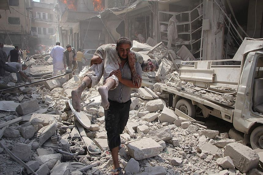An air strike hit the rebel-held Syrian city of Idlib last Saturday. Rebel factions have welcomed the US-Russian deal for a ceasefire, but with reservations about the handling of violations by the government side.