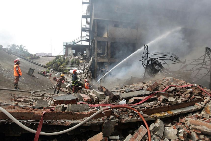 Bangladeshi firefighters try to extinguish a fire that broke out after an explosion in a factory in the key Bangladeshi garment manufacturing town of Tongi on Sept 11, 2016.