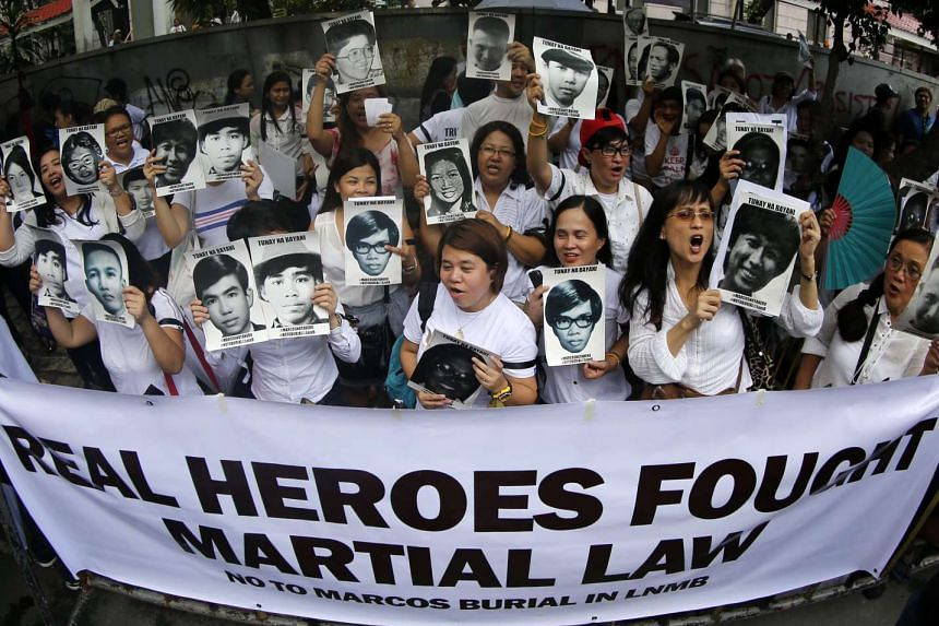 People protest against the burial of late Filipino dictator Ferdinand Marcos at the Heroes cemetery in front of the Supreme Court in Manila on Sept 7, 2016.