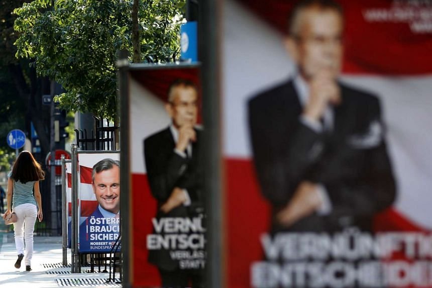 Presidential election campaign posters of candidates Norbert Hofer (left) and Alexander Van der Bellen are seen in Vienna, Austria.