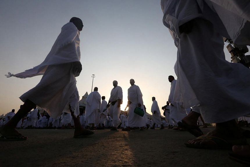 Muslim pilgrims walk in Mina before they move to the plains of Arafat, near the holy city of Mecca, Saudi Arabia on Sept 10, 2016.
