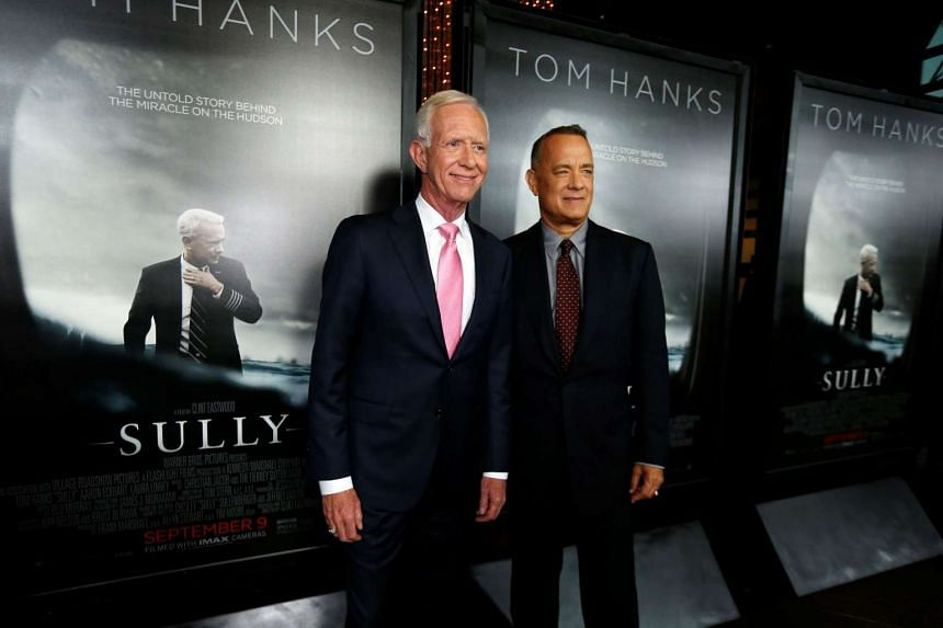 """Tom Hanks (right) poses with the real Captain Chesley """"Sully"""" Sullenberger at the premiere of Sully  in Los Angeles on Thursday (Sept 8)."""