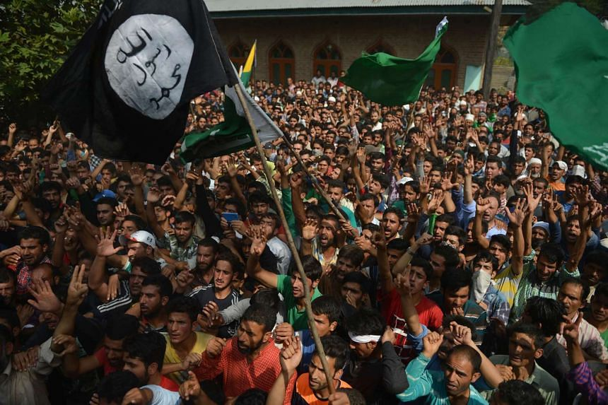 Indian Kashmiri Muslims shout pro-independence slogans at the funeral of Javed Ahmad Dar, 23, in central Kashmir on Sunday (Sept 11).