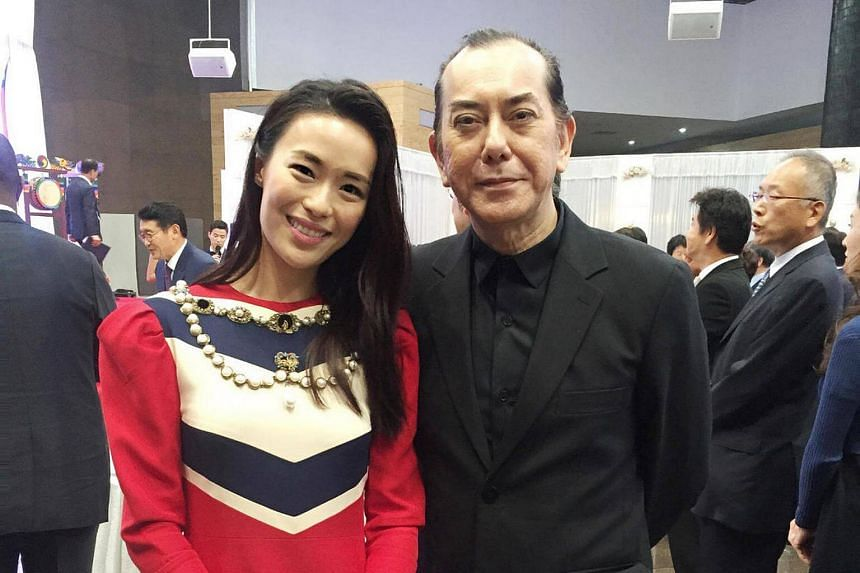 Rebecca Lim poses for a photo with Hong Kong actor Anthony Wong at the Seoul International Drama Awards.
