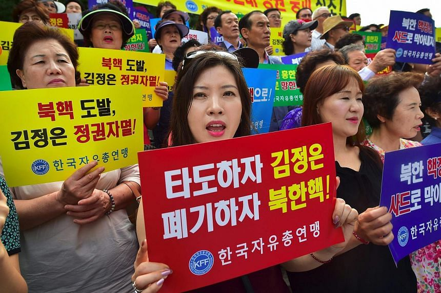 South Korean protestors demonstrating against North Korea's latest nuclear test, in Seoul on Sept 12, 2016.