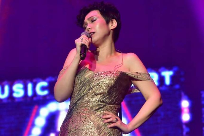 Kit Chan wowing the crowd with her sassy rendition of Marilyn Monroe's My Heart Belongs To Daddy.
