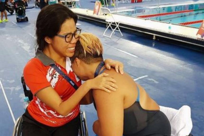 Para-swimmers Yip Pin Xiu (left) and Theresa Goh sobbing in joy after the latter's bronze medal in the 100m breaststroke SB4 event.
