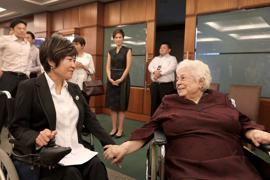 Nominated MP Chia Yong Yong interacting with Mrs Nathan (centre) on Sept 13, 2016.