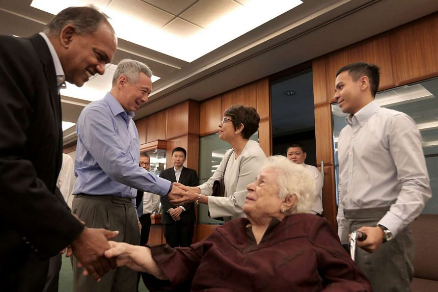 Mrs Nathan (centre) interacting with PM Lee Hsien Loong and Home Affairs and Law Minister K Shanmugam.
