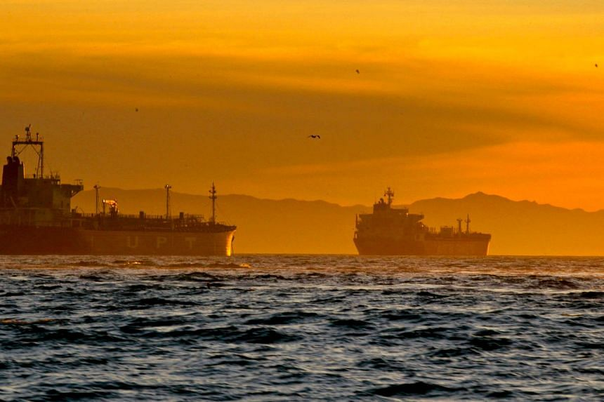 Oil tankers anchored near the Port of Long Beach, California, US. Ultra-low crude prices and cheap shipping rates are encouraging exotic new oil trading routes.