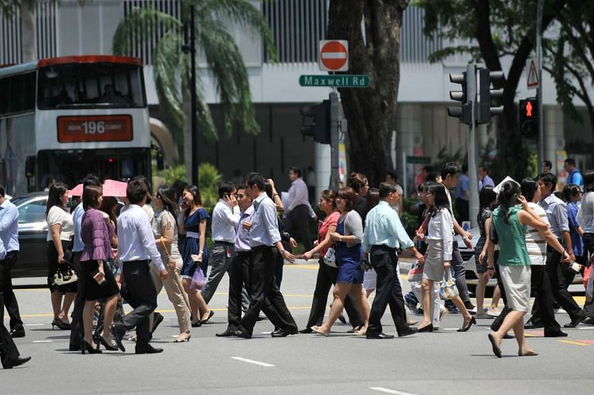 Office workers crossing Maxwell Road in the central business district (CBD) area.