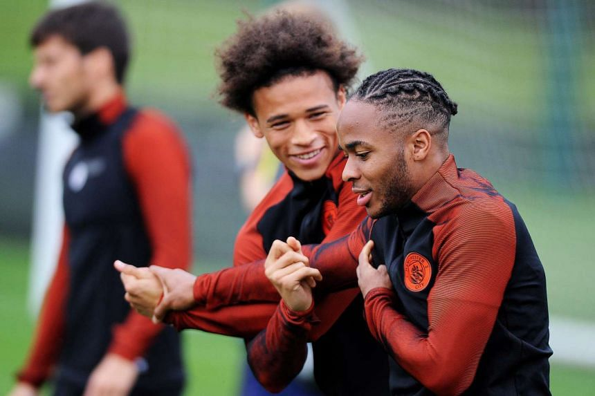 Manchester City players Raheem Sterling (right) and Leroy Sane (centre) attending a training session in Manchester on Sept 12, 2016.