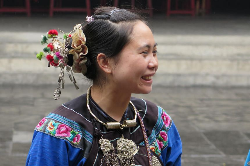 A girl from the Miao or Hmong minority in Fenghuang in China's central Hunan province. Together with the Tujia ethnic group, the Miao people have lived in the region for thousands of years and make up most of Fenghuang's residents.