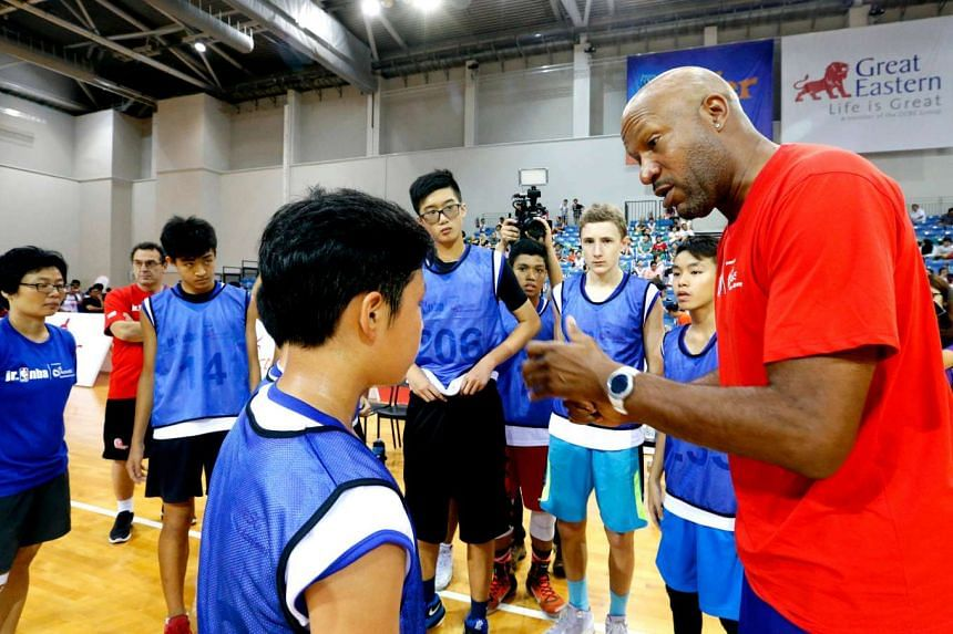 Ron Harper (right) conducted the inaugural Junior NBA Singapore 2016 National Training Camp where 15 children from Singapore will form part of the Junior NBA All-Stars from South-east Asia.