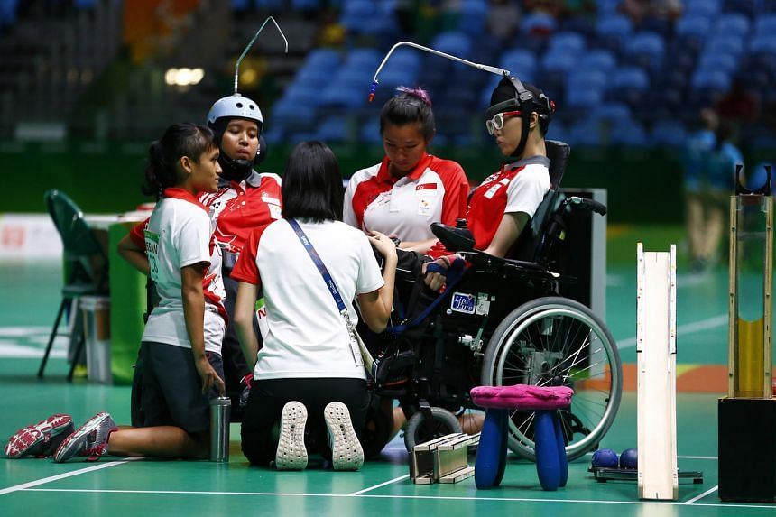 Singapore's Nurulasyiqah Taha and Toh Sze Ning talk with their coaches during their semi-final match on Sept 11.