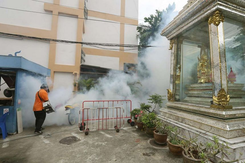 A Thai health official sprays chemicals to kill mosquitoes in Sathon district in Bangkok on Sept 13, 2016.