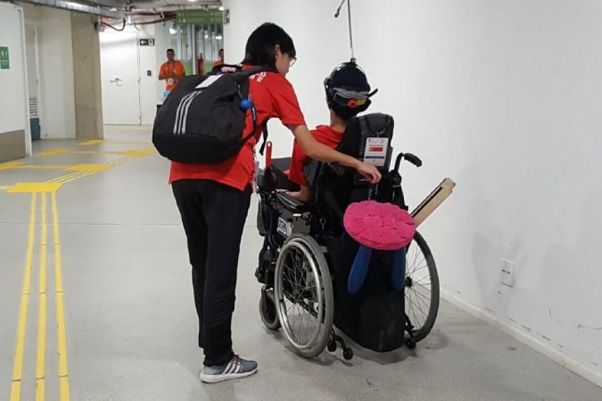Boccia player Toh Sze Ning (in wheelchair), 23, with her coach Tess Tan at the mixed zone of Carioca Arena 2 in Rio.