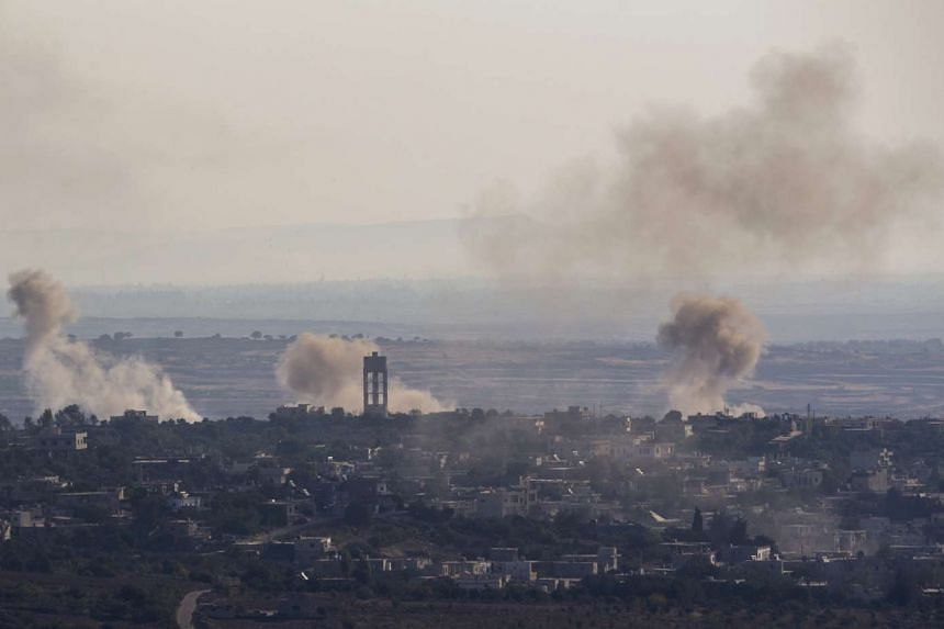Smoke is seen rising from the village of Jubata, north of Quneitra, Syria, in a picture taken from the Israeli side of the border on Sept 11, 2016.