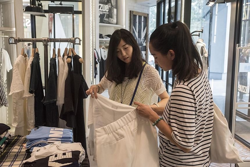 Ms Wu Jingjing (left) shopping with her friend, Pengpeng, in Beijing. Ms Wu, who works at an Internet company, says young Chinese no longer just want someone to marry, they want a relationship based on love.