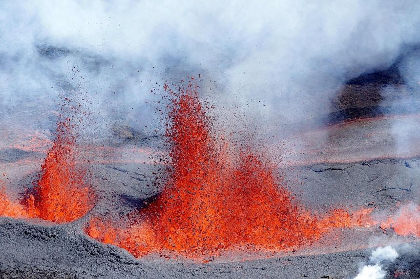 Molten lava spewing from the volcano Piton de la Fournaise, literally Peak of the Furnace, on the eastern side of France's Reunion Island in the Indian Ocean on Sunday. The peak is one of the world's most active volcanoes and has seen more than 150 e