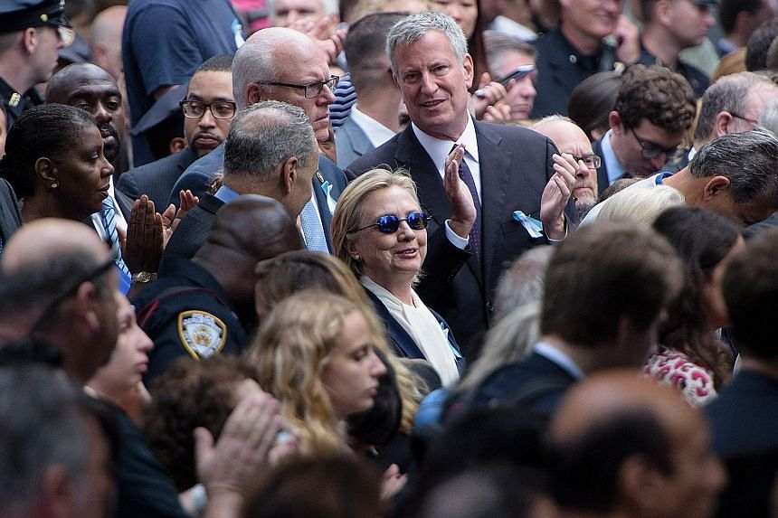 Mrs Clinton at the Sept 11 memorial service in New York on Sunday, which she had to leave abruptly after suffering from dehydration. The 68-year-old's doctor said she had been experiencing a cough related to allergies and was diagnosed with pneumonia