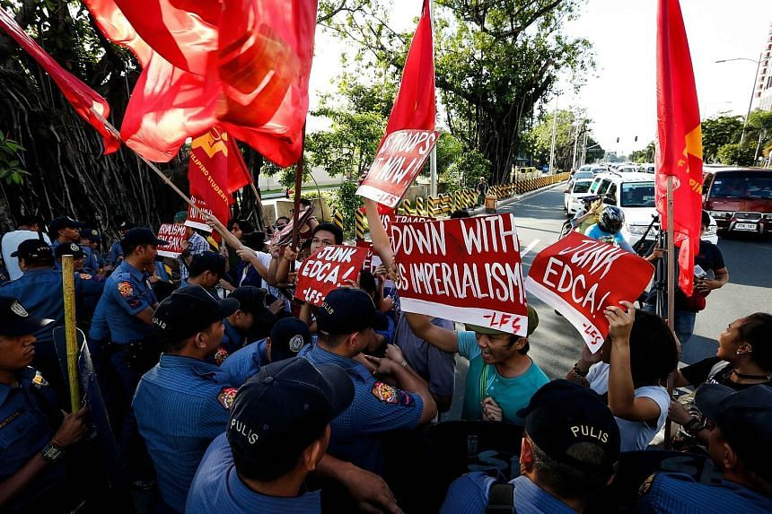 Activists from the League of Filipino Students staging a protest against continuing US intervention in the country near the US Embassy in Manila on Sunday.