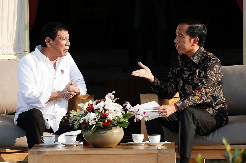 Left: Philippine President Rodrigo Duterte (far left) with Indonesian President Joko Widodo at the presidential palace in Jakarta on Friday. Mr Joko told reporters that Mr Duterte had told him to go ahead with the execution of Filipino death row pris