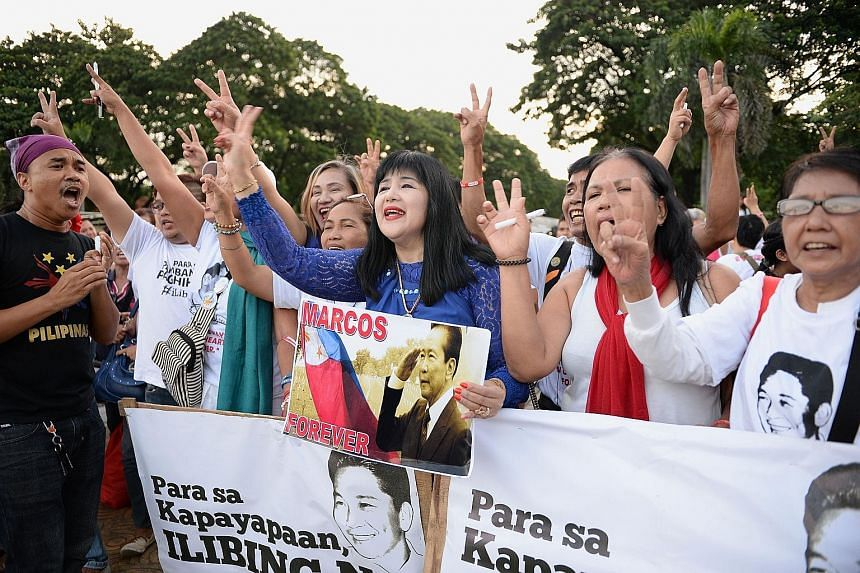 Supporters of late Philippine dictator Ferdinand Marcos after releasing balloons to celebrate his birth anniversary at a park in Manila on Sunday. President Rodrigo Duterte - a Marcos ally - recently reignited squabbles over Mr Marcos' legacy with a